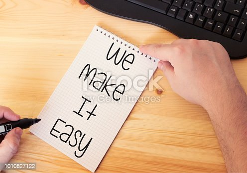 istock Handwriting Announcement text showing We Make It Easy on notebook 1010827122