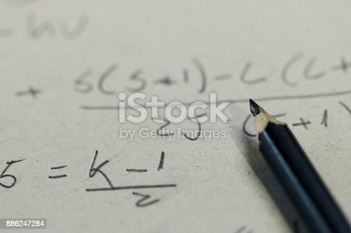 1148553584istockphoto Handwriting formula on a paper with pen 886247284