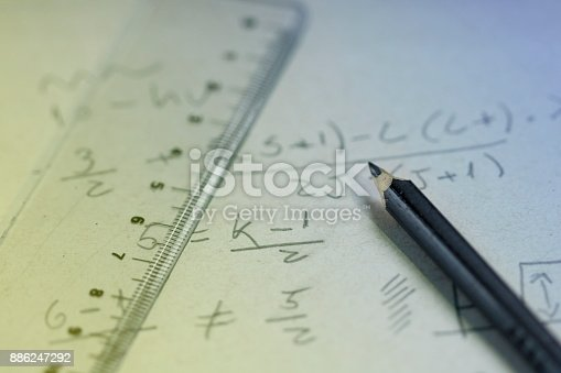 1148553584istockphoto Handwriting formula on a paper with pen 886247292