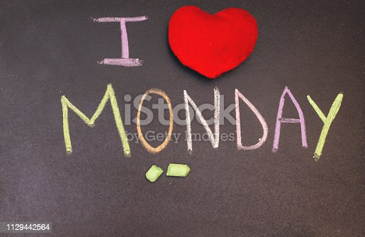 istock handwriting i love monday on chalkboard with colorful chalk and wooden heart 1129442564