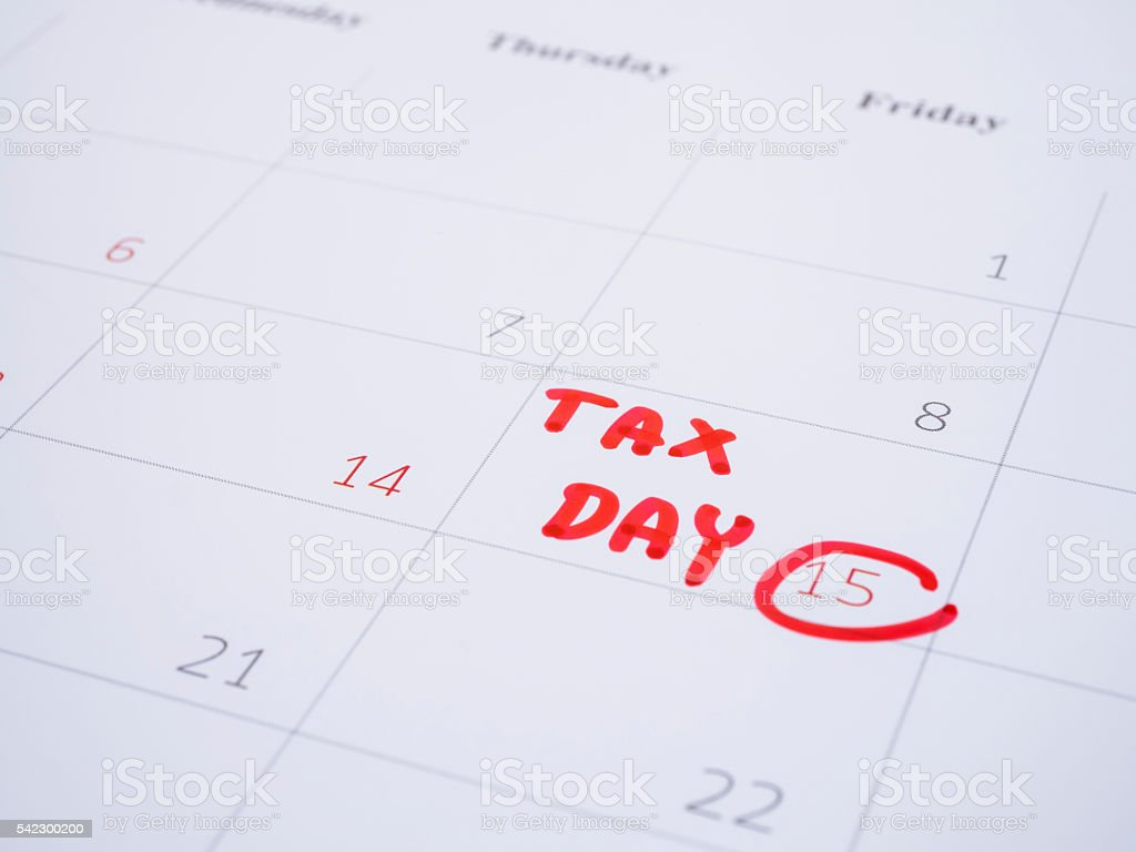 Handwriting tax day 1 stock photo