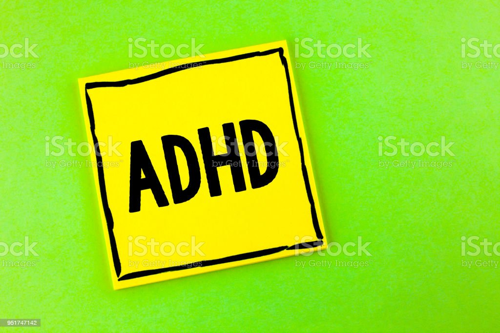 Handwriting text Adhd. Concept meaning Learning made easier for children teaching no more a difficult task written on Yellow Sticky Note Paper on the plain background. stock photo
