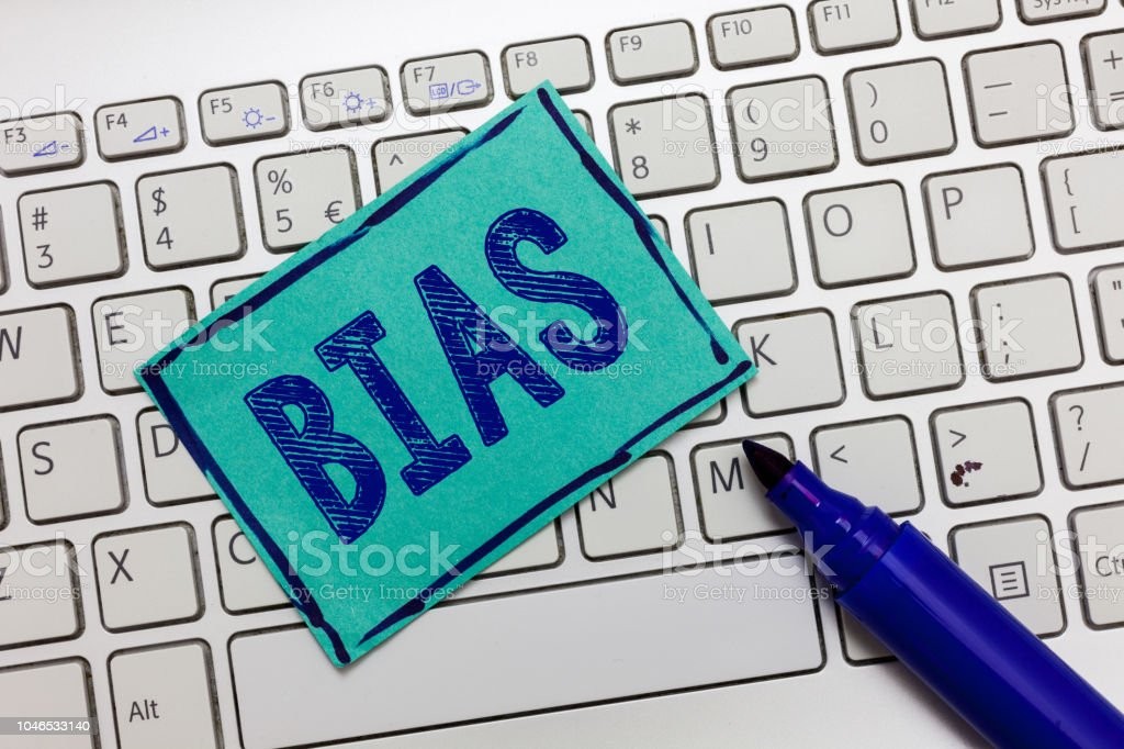 Handwriting text Bias. Concept meaning Prejudice in favor of and against one thing Considered to be Unfair stock photo