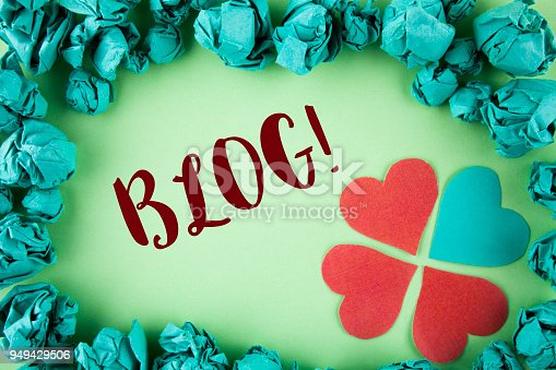 istock Handwriting text Blog Motivational Call. Concept meaning Preperation of Attractive content for blogging websites written on plain background within Paper Balls Hearts next to it. 949429506