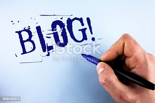 istock Handwriting text Blog Motivational Call. Concept meaning Preperation of Attractive content for blogging websites written by Man on plain background holding Marker in Hand. 949446424