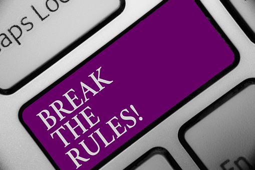 istock Handwriting text Break The Rules. Concept meaning Make changes do everything different Rebellion Reform Keyboard button hit key type message office work computer input device. 999230688