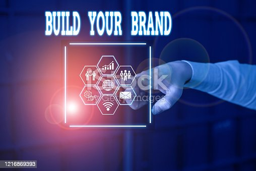 istock Handwriting text Build Your Brand. Concept meaning enhancing brand equity using advertising campaigns Picture photo system network scheme modern technology smart device. 1216869393