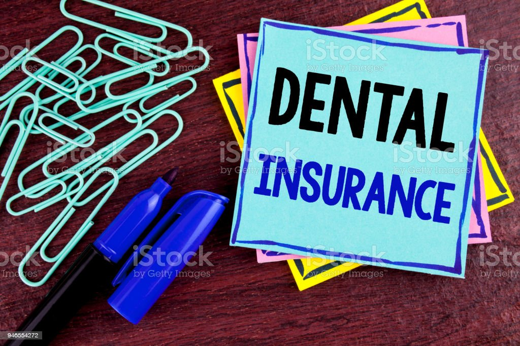 Handwriting text Dental Insurance. Concept meaning Dentist healthcare provision coverage plans claims benefit written on Sticky Note Paper on wooden background Marker and Paper Clips next to it. stock photo