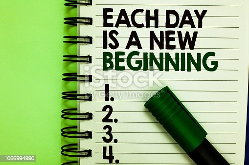 istock Handwriting text Each Day Is A New Beginning. Concept meaning Every morning you can start again Inspiration Written letters and numbers on notepad laid green marker green back. 1066994990