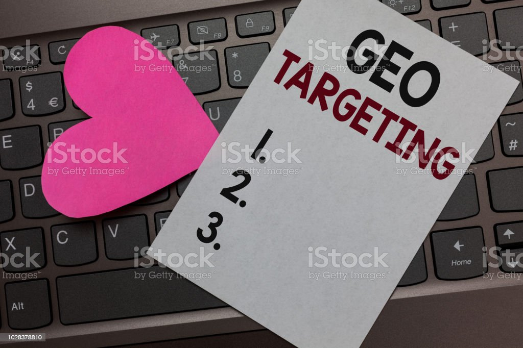 Handwriting text Geo Targeting. Concept meaning Digital Ads Views IP Address Adwords Campaigns Location Paper Romantic lovely message Heart Keyboard Type computer Good feelings – zdjęcie