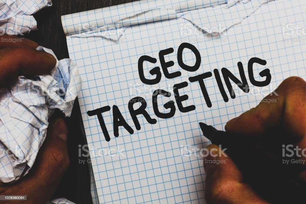 Handwriting text Geo Targeting. Concept meaning Digital Ads Views IP Address Adwords Campaigns Location Man holding marker notebook crumpled papers ripped pages mistakes made – zdjęcie