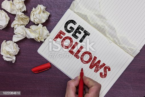 istock Handwriting text Get Follows. Concept meaning person who imitates copies or takes as model ideal person Man holding marker notebook page crumpled papers several tries mistakes. 1022084610