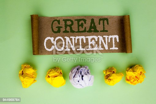 istock Handwriting text Great Content. Concept meaning Excellent Information Valuable Interesting Good Convenient written on Cardboard Paper on the plain background Paper Balls next to it. 944969764