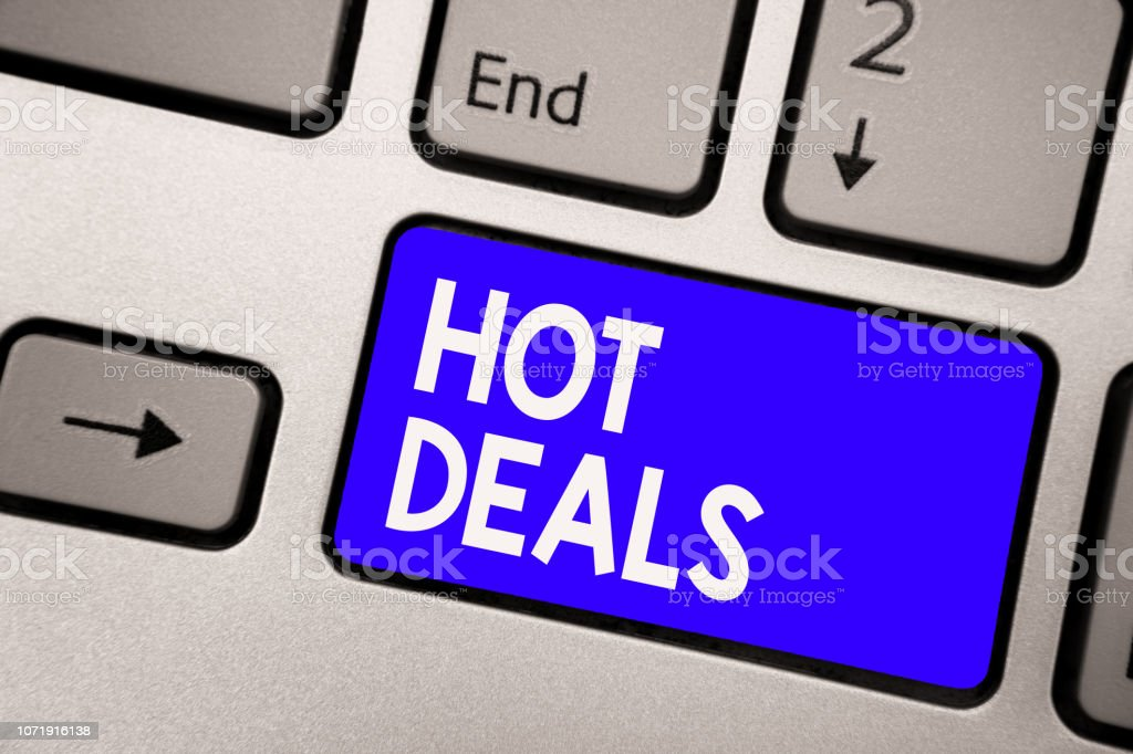 Handwriting text Hot Deals. Concept meaning An agreement through which one of the paties is offered and accept Keyboard blue key Intention create computer computing reflection document. stock photo