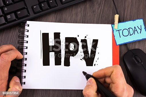 istock Handwriting text Hpv. Concept meaning Human Papillomavirus Infection Sexually Transmitted Disease Illness written by Man on Notepad on wooden background Marker Today Mouse Keyboard next to it. 949457354