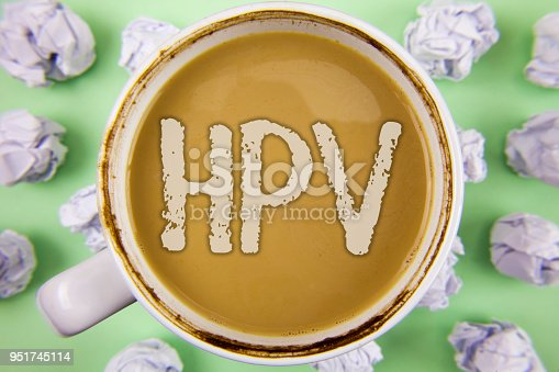 istock Handwriting text Hpv. Concept meaning Human Papillomavirus Infection Sexually Transmitted Disease Illness written on Tea in White Cup within Crumpled Paper Balls on plain Green background. 951745114