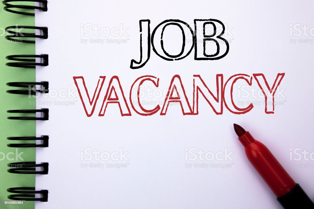 Handwriting text Job Vacancy. Concept meaning Work Career Vacant Position Hiring Employment Recruit Job written on Notebook Book on the plain background Marker next to it. stock photo