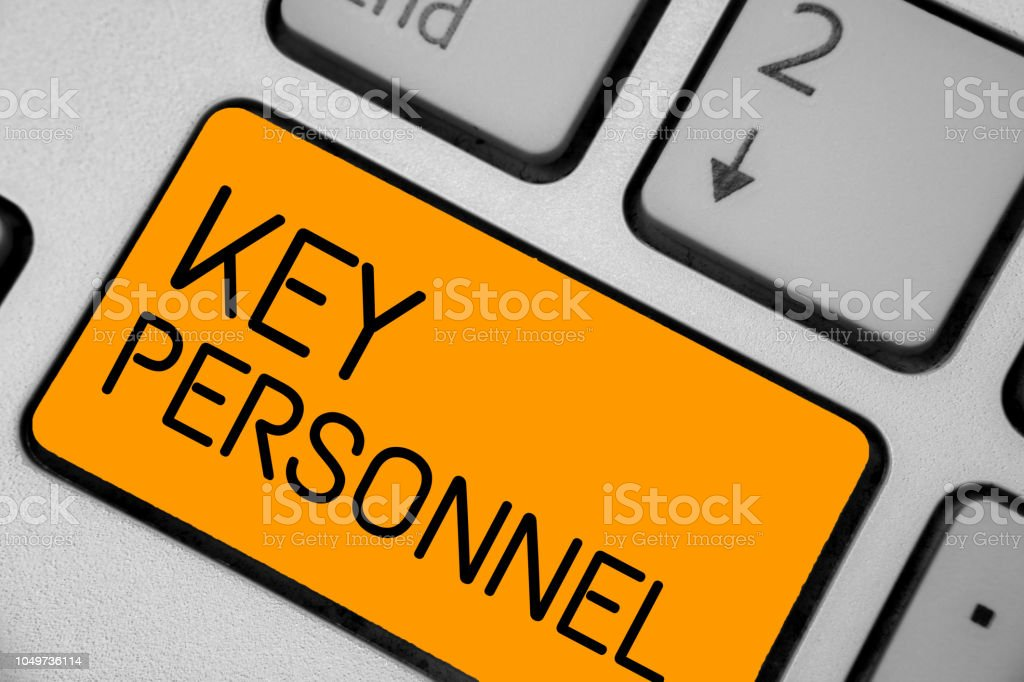 Handwriting text Key Personnel. Concept meaning Program Directors Principal Investigator Project Executives Keyboard orange key Intention create computer computing reflection document. stock photo