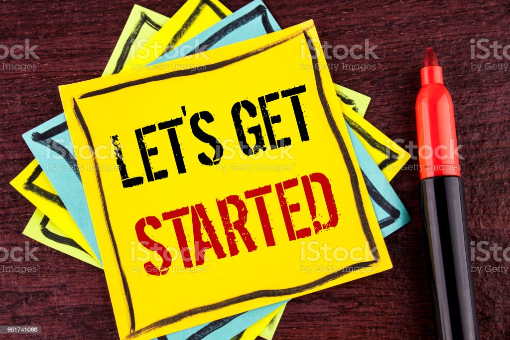 Handwriting text Lets Get Started. Concept meaning beginning time motivational quote Inspiration encourage written on Yellow Sticky note paper on wooden background Marker next to it. stock photo