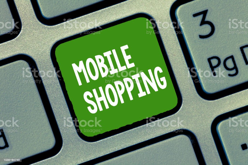 Handwriting text Mobile Shopping. Concept meaning Buying and selling of goods and services through mobile stock photo