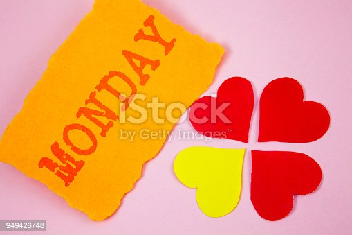 istock Handwriting text Monday. Concept meaning First day of the week Back to work Weekend is over Wakeup Early written on Tear plain Orange paper on plain background Paper Love Hearts next to it. 949426748