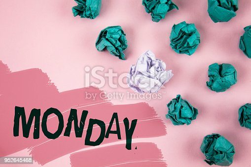 istock Handwriting text Monday. Concept meaning First day of the week Back to work Weekend is over Wakeup Early written on Painted Pink background Crumpled Paper Balls next to it. 952645468