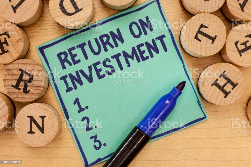 Handwriting text Return On Investment. Concept meaning Ratio between the Net Profit and Cost invested stock photo