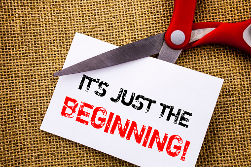 istock Handwriting text showing It Is Just The Beginning. Conceptual photo Goal Success Plan For New Dream Life Career written on Sticky Note Paper Cutting by Scissors on the textured background 947549300