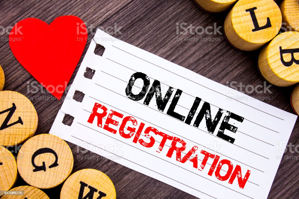 Handwriting text showing Online Registration. Conceptual photo Register Web Subscription Subscribe written on tear note paper sticky note on the wooden background with heart. stock photo