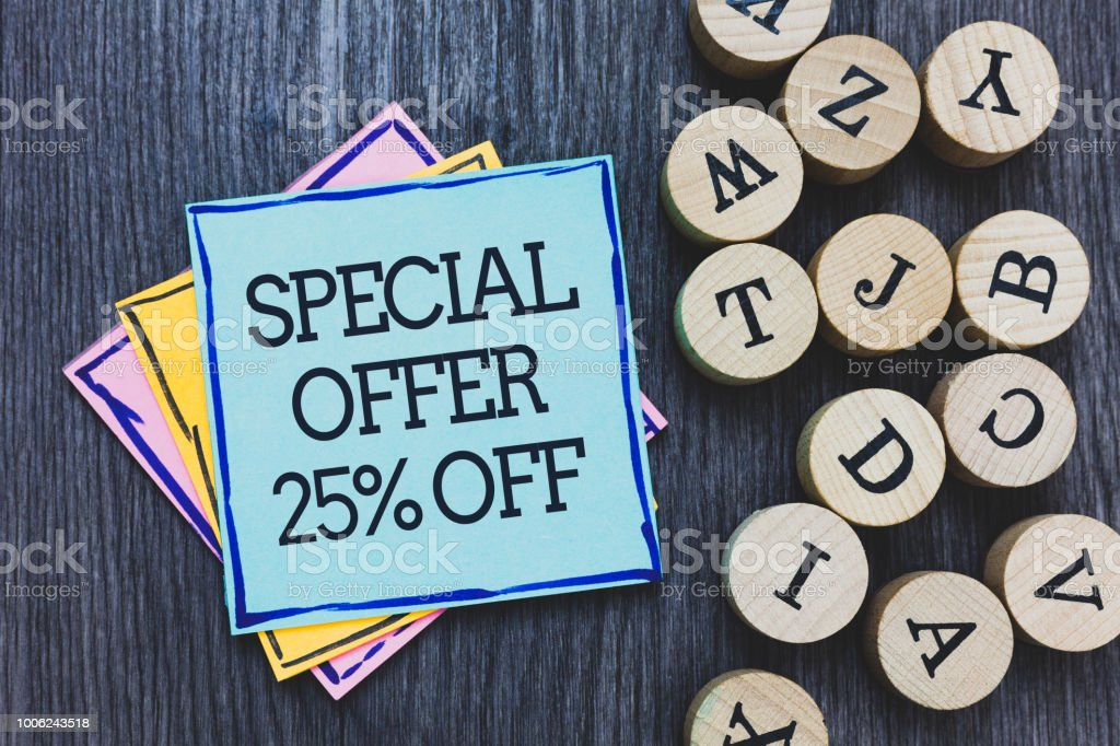 Handwriting text Special Offer 25 Off. Concept meaning Discounts promotion Sales Retail Marketing Offer Black wooden deck written sticky note beside some round woody alphabets. stock photo