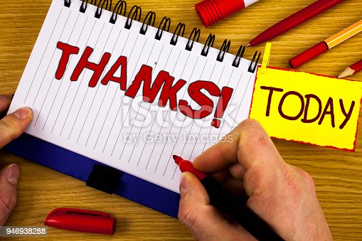 1068057218 istock photo Handwriting text Thanks Motivational Call. Concept meaning Appreciation greeting Acknowledgment Gratitude written by Marker in Hand on Notebook on wooden background Today Pen Pencil next to it 946938288