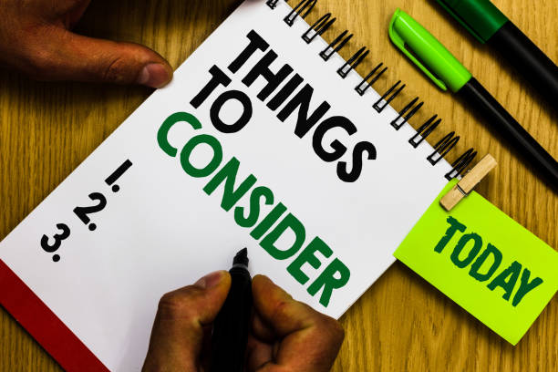 Handwriting text Things To Consider. Concept meaning list to check or do it Shopping Schedule Time table Diary pen notepad ring pen marker pointer script daily work handwriting. stock photo