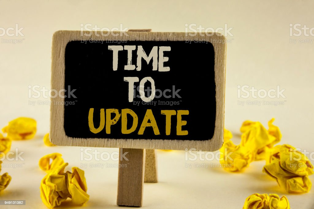 Handwriting text Time To Update. Concept meaning Renewal Updating Changes needed Renovation Modernization written on Wooden Notice Board on the plain background Paper Balls next to it. stock photo