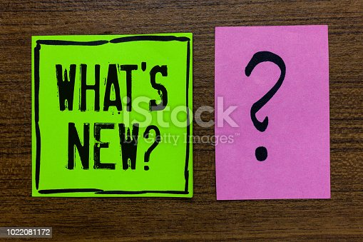 istock Handwriting text What s is New question. Concept meaning Asking about latest Updates Trends Happening News Green paper note Important reminder pink question mark wooden background. 1022081172