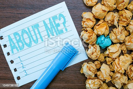 istock Handwriting text writing ABOUT ME question. Concept meaning Interrogating oneself Letting other showing knows you 1049736182