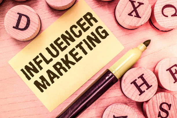 Handwriting text writing Influencer Marketing. Concept meaning Endorser who Influence Potential Target Customers stock photo