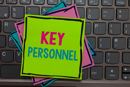 istock Handwriting text writing Key Personnel. Concept meaning Program Directors Principal Investigator Project Executives Papers reminders keyboard Inspiration communicate Annotations Type computer. 1049733330