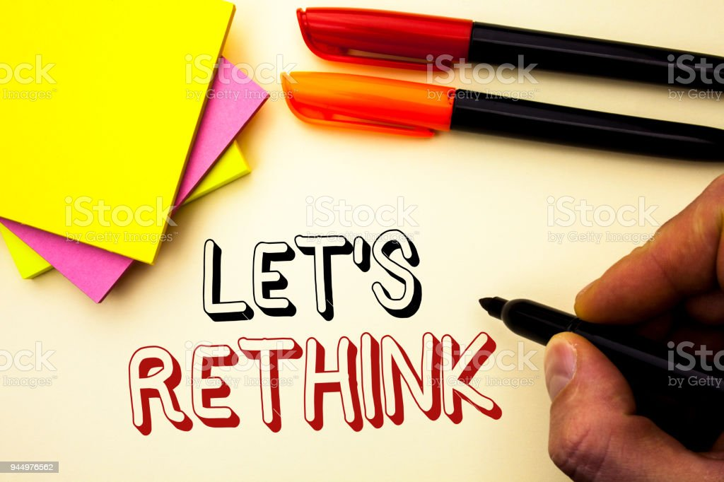 Handwriting text writing Let Us Rethink. Concept meaning Give people time to think things again Remodel Redesign written by Marker on the plain background Pen and Sticky Notes next to it. stock photo