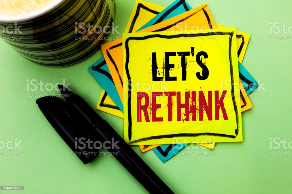 Handwriting text writing Let Us Rethink. Concept meaning Give people time to think things again Remodel Redesign written on Sticky Note Paper on the Plain background with Pen and Coffee Cup. stock photo