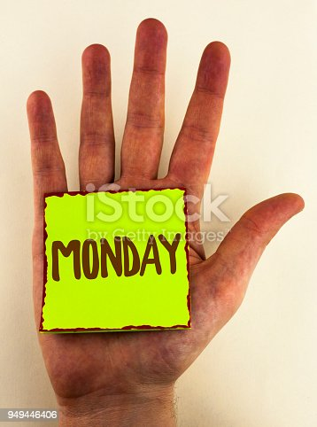 istock Handwriting text writing Monday. Concept meaning First day of the week Back to work Weekend is over Wakeup Early written on Sticky Note Paper placed on Hand on the plain background. 949446406