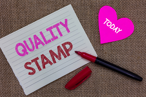 istock Handwriting text writing Quality Stamp. Concept meaning Seal of Approval Good Impression Qualified Passed Inspection Piece notebook paper heart jute background open marker Communicating ideas. 1046618696