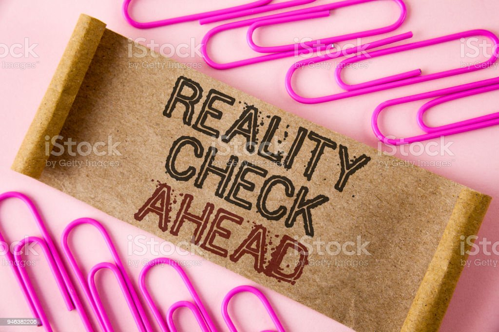 Handwriting text writing Reality Check Ahead. Concept meaning Unveil truth knowing actuality avoid being sceptical written on Folded Cardboard paper piece on plain background within Paper Pins stock photo