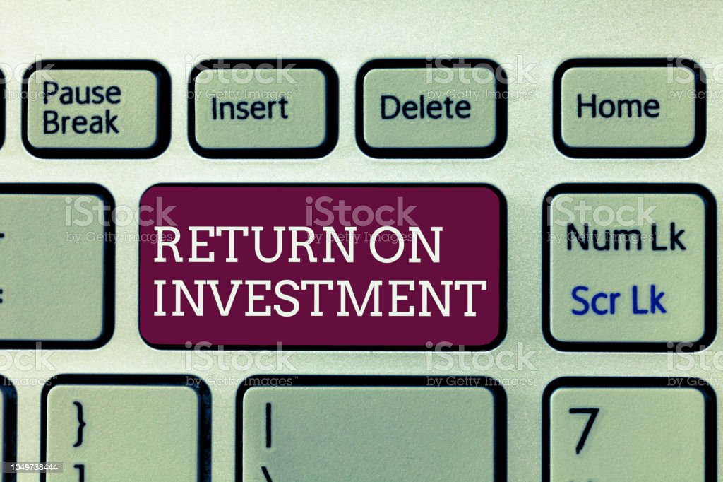 Handwriting text writing Return On Investment. Concept meaning Ratio between the Net Profit and Cost invested stock photo