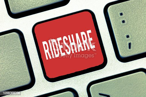 istock Handwriting text writing Rideshare. Concept meaning Sharing rides or transportation Carpool Online Taxi service 1056068206