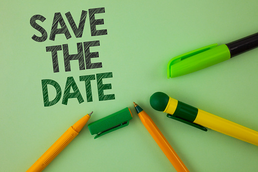 istock Handwriting text writing Save The Date. Concept meaning Organizing events well make day special by event organizers written on Plain Green background Pens next to it. 946563864