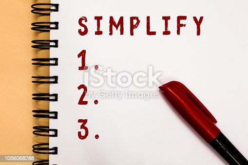 istock Handwriting text writing Simplify. Concept meaning make something simpler or easier to do or understand unravel Marker over open spiral notebook white page communicating ideas messages. 1056068288