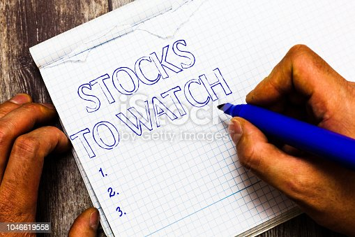 istock Handwriting text writing Stocks To Watch. Concept meaning being heavy broker and watch every increase decrease 1046619558