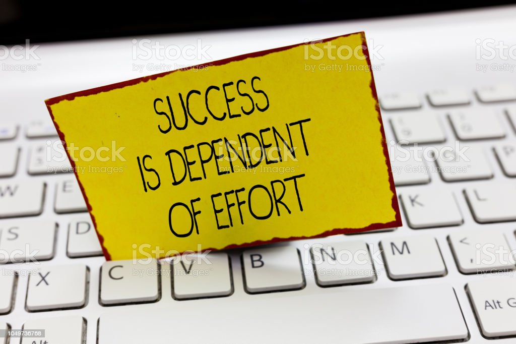 Handwriting text writing Success Is Dependent Of Effort. Concept...