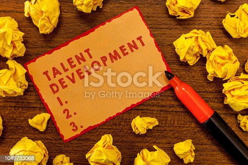 istock Handwriting text writing Talent Development. Concept meaning Building Skills Abilities Improving Potential Leader 1049733068