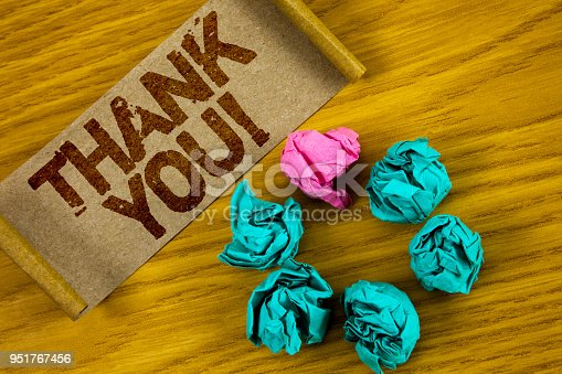 1068057218 istock photo Handwriting text writing Thank You Motivational Call. Concept meaning Appreciation greeting Acknowledgment Gratitude written on Folded Cardboard Paper piece on wooden background Paper Balls. 951767456